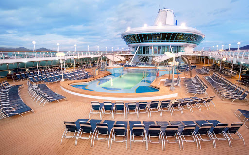 Splendour-of-the-Seas-Pool-Deck - Splendour of the Seas' main pool area has plenty of space to swim or lounge in deck chair.