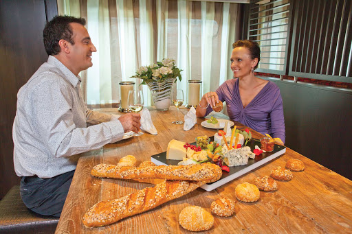 AmaBella-Wine-Bar-couple - Enjoy a glass of wine and an exquisite cheese spread in AmaBella's wine bar during your European travels.