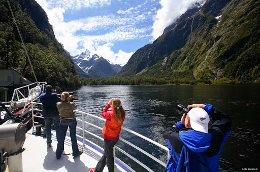 Camera_action_Milford_Sound - How much natural grandeur can you handle? You'll find out at Milford Sound, where the scenery comes in just one size: extra large. Peaks rise straight out of the water and fairy tale waterfalls fill the air with mist.