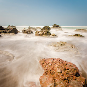 Flightless Rock by M. Tuflichun Alfath - Landscapes Waterscapes ( wavy, blue sky, blue, waves, rock, beach, rocks )