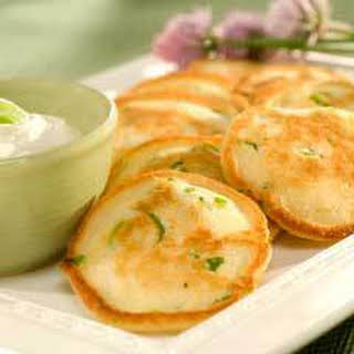 Savory Appetizer Pancakes With Garlic Sour Cream.