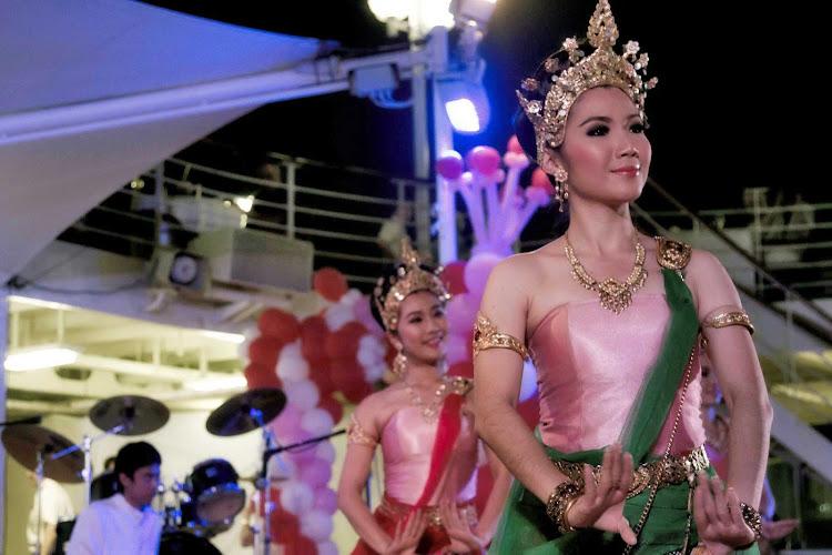 Elegant dancers offer a glimpse into Thai culture with the Bangkok Thai show on board an Azamara cruise.