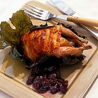Roast Quail Wrapped in Pancetta and Vine Leaves with Grape Confit