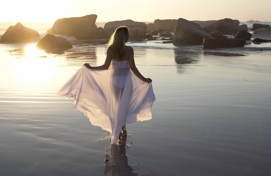 Walking into sunset by Peter Wilkins - People Portraits of Women ( reflection, girl, sunset, sea, white dress, beach, rocks )