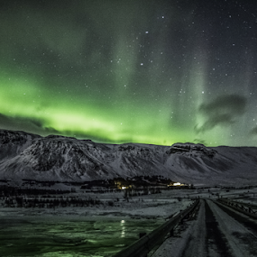Aurora on the mountain...... by Kristvin Guðmundsson - Landscapes Mountains & Hills ( railing, canon, green, northern lights, aurora, 60d, cloads, rokinon, mountains, iceland, forrest, stars, kristvin, ice, snow, esjan, trees, bridge, river,  )