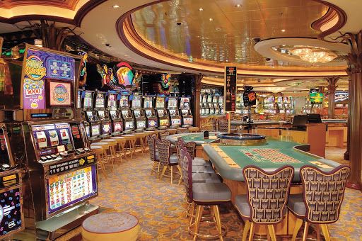 Jewel-of-the-Seas-Casino-Royale - Step into Casino Royale aboard Jewel of the Seas and try your luck at several slot machines and card table games.