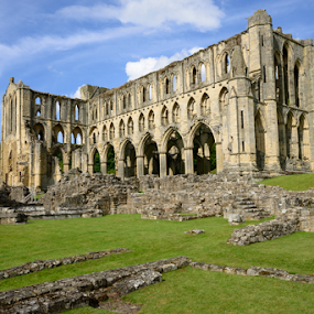 Rievaulx Abbey by Maurizio Martini - Buildings & Architecture Public & Historical ( old, exterior, stone, north, architecture, historic, religion, england, sky, yorkshire, ruins, abbey, clouds, building, park, national, monastic, cloudscape, cistercian, stonework, facade, blue, monastery, outdoor, rievaulx, architectural, historical, english, outside, religious,  )