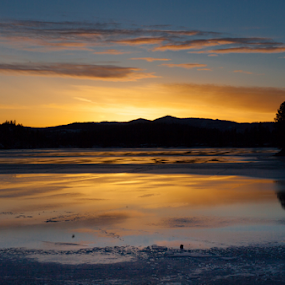 Going Down in Fernan by Shaun Schlager - Landscapes Sunsets & Sunrises ( idaho, orange, winter, fernan, sunset, ice, yellow )
