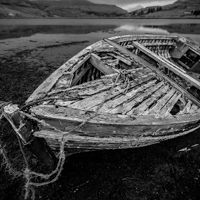 a long since abandoned boat on the shore at Carbost by Ben Leng - Black & White Objects & Still Life