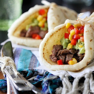 Restaurant Style Carne Asada Soft Tacos with Guacamole and Corn.