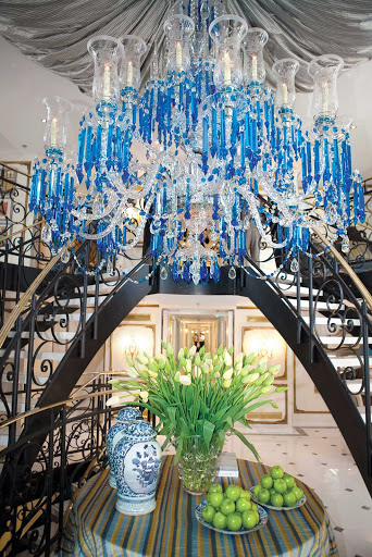 A magnificent crystal Baccarat chandelier greets guests in the foyer of the S.S. Antoinette cruise ship.