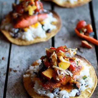 Caribbean Jerk Salmon Tostadas with Grilled Pineapple Peach Coconut Salsa.