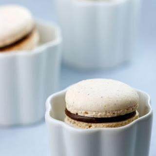 Italian Meringue Hazelnut Macarons with Chocolate Hazelnut Spread.