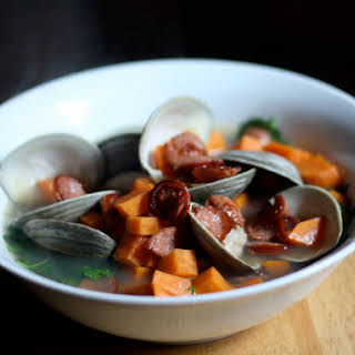 Clams with Sweet Potato Smoked Sausage and Watercress.