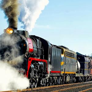 Steam Train On Track.jpg