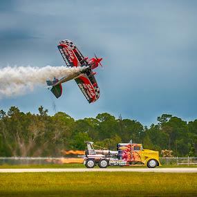 The Race Is On by Sandy Friedkin - Transportation Airplanes ( rocket truck, airport, bi-plane, race, smoke,  )