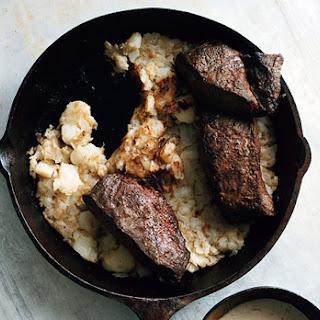 Flatiron Steaks with Creamy Juniper Sauce with Hash Browns.