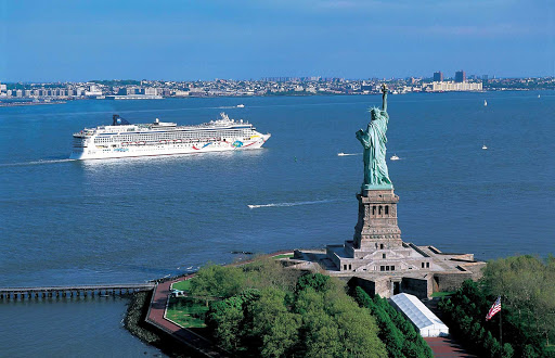 Norwegian Dawn cruising by the Statue of Liberty in New York.