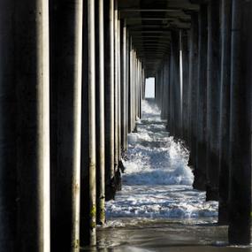 Under the HB Pier  by Dory Formiller - Buildings & Architecture Bridges & Suspended Structures ( water, suspended structure, buildings, pier, ocean, architecture, pillers, bridges )