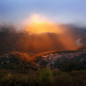 Close Sunset of the Third Kind by Paolo Lazzarotti - Landscapes Sunsets & Sunrises ( amazing, hill, long shadow, drizzle, villages, rays, heavy clouds )
