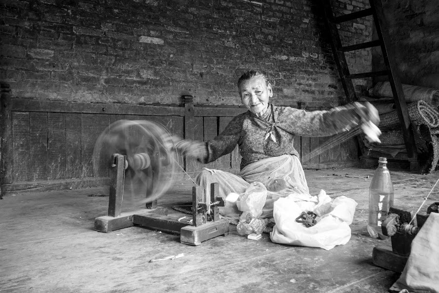 The Wheel of Time by Veronika Kovacova - People Street & Candids ( old, kathmandu, old lady, spinning, wheel, black and white, woman, street, old woman, portrait, street photography, nepal,  )