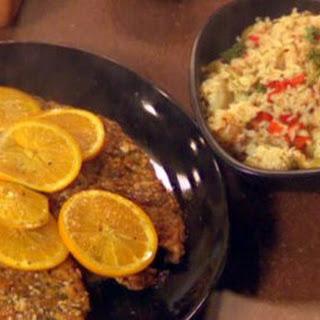 Spanish Chicken Cutlets and Olive Rice with Artichokes and Piquillo Peppers.