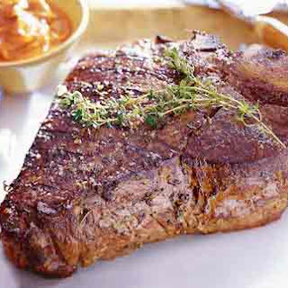 Grilled Porterhouse Steak with Paprika-Parmesan Butter.