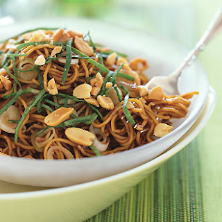 Spicy Sesame Noodles with Chopped Peanuts and Thai Basil.