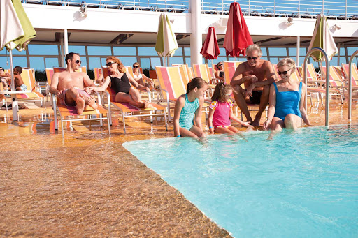 Allure-of-the-Seas-pool-deck-multigenerational - On the pool deck of Allure of the Seas: Make your next vacation a multigenerational affair.