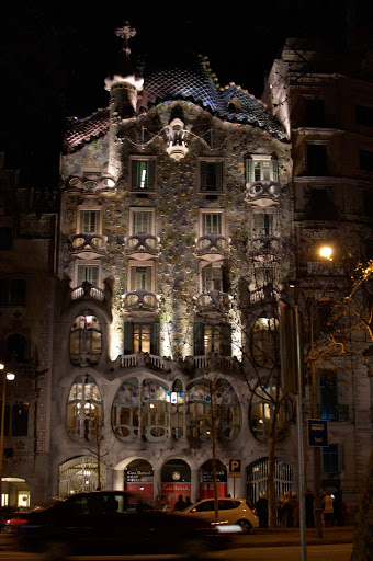 Casa Batlló in central Barcelona at night. A remodel of a previously built house, it was redesigned by Antoni Gaudí from 1904-1906.