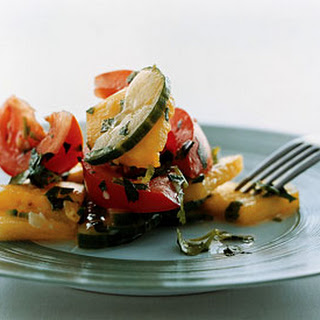 Cucumber, Tomato, and Pineapple Salad with Asian Dressing.