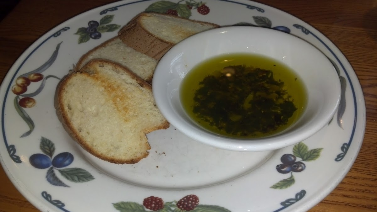 Lightly toasted GF french bread with olive oil dip.