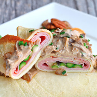 Savory Crepes stuffed with Brie, Ham and Asparagus.