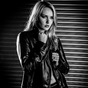 Carla in leather by Peter McLean - Black & White Portraits & People ( leather jacket, blonde, leather trousers, shutters, leggings )