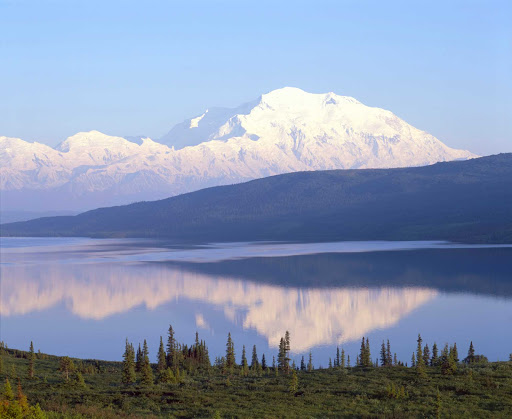 snow-mountain-lake-Denali - The magnitude of the snow-capped peaks reflect in this lake in Denali National Park, Alaska.
