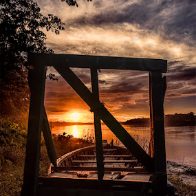 Sunset through the Frame by Manabendra Dey - Landscapes Sunsets & Sunrises ( sunset, evening clouds, sunset through frame, boat, evening )