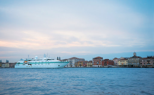 Tere-Moana-Venice-Grand-Canal - Paul Gauguin Cruises' small luxury ship Tere Moana sails through the Grand Canal of Venice, Italy, at dusk.