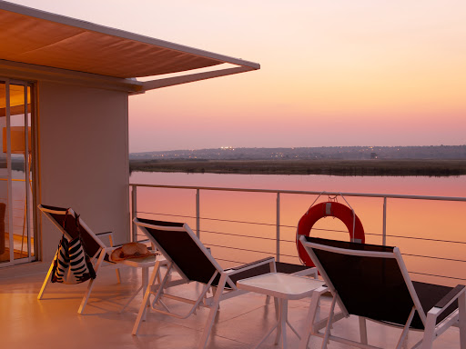 Zambezi-Queen-Sundeck-Balcony - Grab a deck chair — and perhaps your camera — to take in the sunset from aboard the Zambezi Queen.