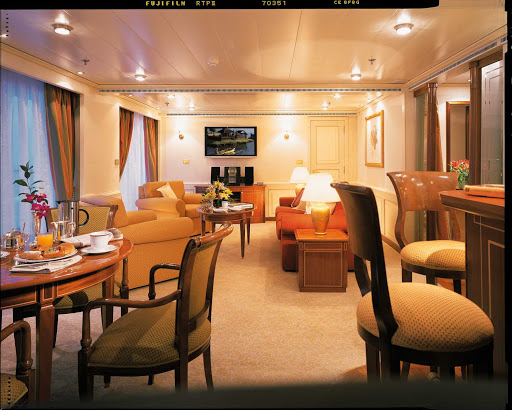 Silversea_Owners_Suite - The Owner's Suite appeals to those who want the most luxurious stateroom aboard Silver Shadow. It offers a large teak veranda, living room, separate dining area and bar, and a well-appointed bathroom.