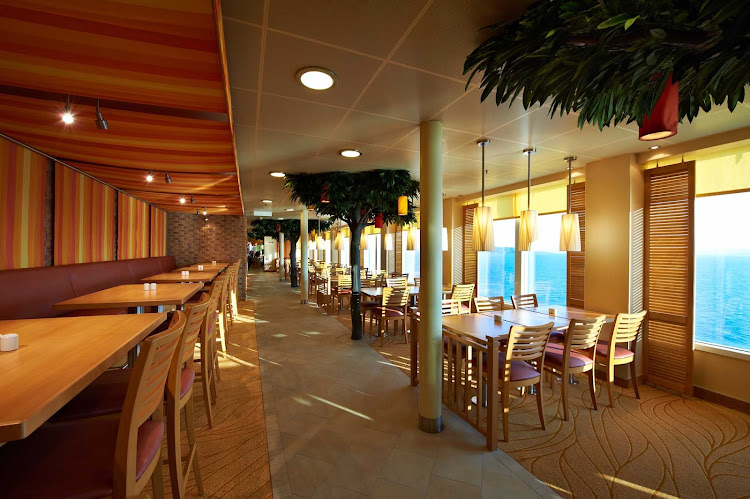 Get up-close views of seascapes during meals in the Lido Dining room aboard Carnival Breeze.