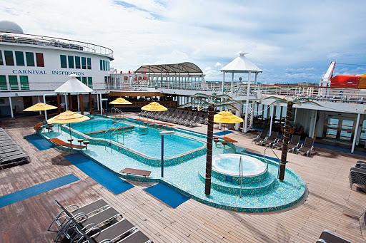 Carnival-Inspiration-Lido-Pool - Join the family for a swim, or unwind with a tropical drink and a soak in one of the whirlpools on Carnival Inspiration's Lido pool deck.