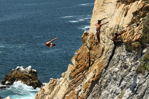 cliff-divers-La-Quebrada-Acapulco - The famed cliff divers (clavadistas) doing their thing — including a triple somersault — at La Quebrada in Acapulco, Mexico.