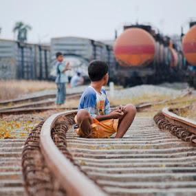 don't look back by Kesuma Wijaya - Babies & Children Children Candids ( child, rail, candid, portrait )