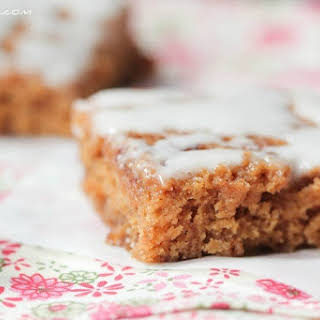 Cinnamon Roll Swirled Gingerbread Bars with Toffee Chips.