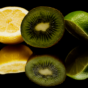 Some fruits by Roman Kolodziej - Food & Drink Fruits & Vegetables ( fresh, green, kiwi, fruits, background, healthy, yellow, black, lemon, Food & Beverage, meal, Eat & Drink )