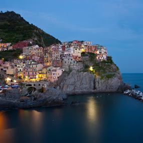 One of the best night shot spots in the world! by Gale Perry - Landscapes Waterscapes ( sea scape, reflection, cinque terre, manarola, dusk, italy, , relax, tranquil, relaxing, tranquility )