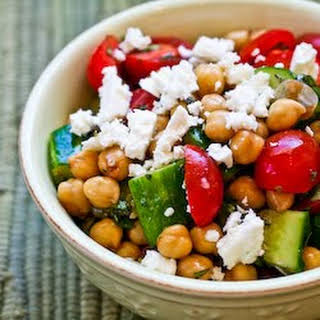 Cucumber and Tomato Salad with Marinated Garbanzo Beans, Feta, and Herbs.