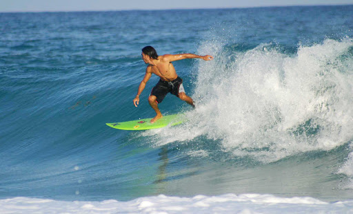 Surfers enjoy the wicked waves and laid-back style of Cozumel.