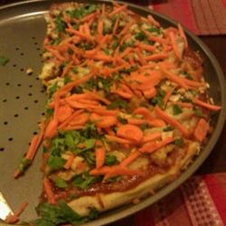 Thai Chicken Pizza with Carrots and Cilantro.