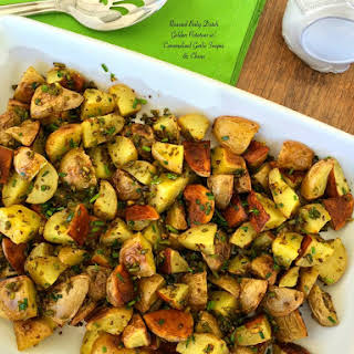 Roasted Baby Dutch Golden Potatoes w/ Caramelized Garlic Scapes & Chives.